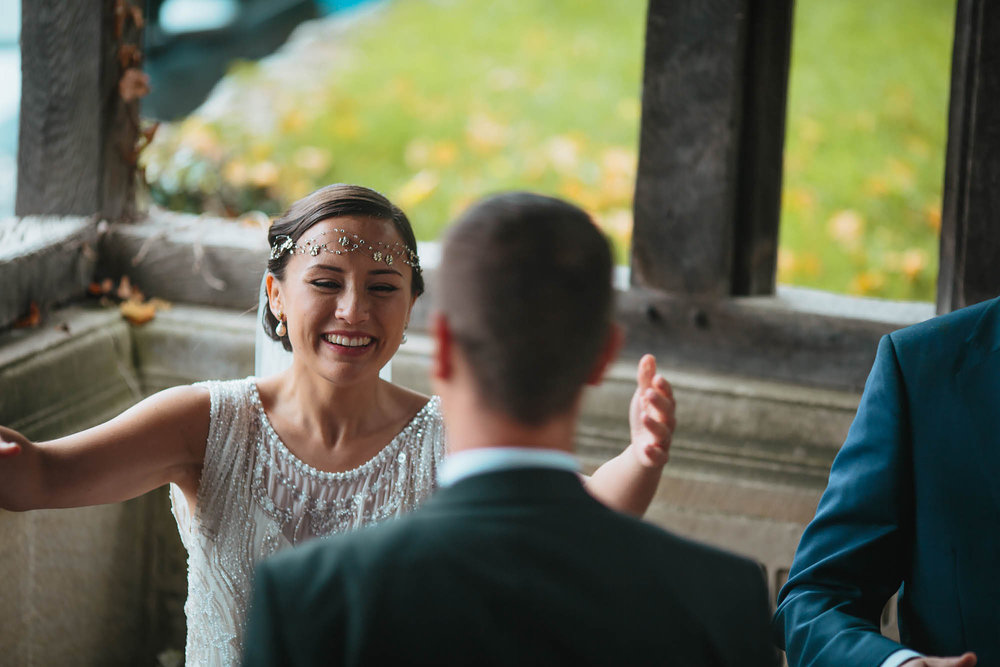 Bride laughing and greeting guests at her wedding in Yorkshire