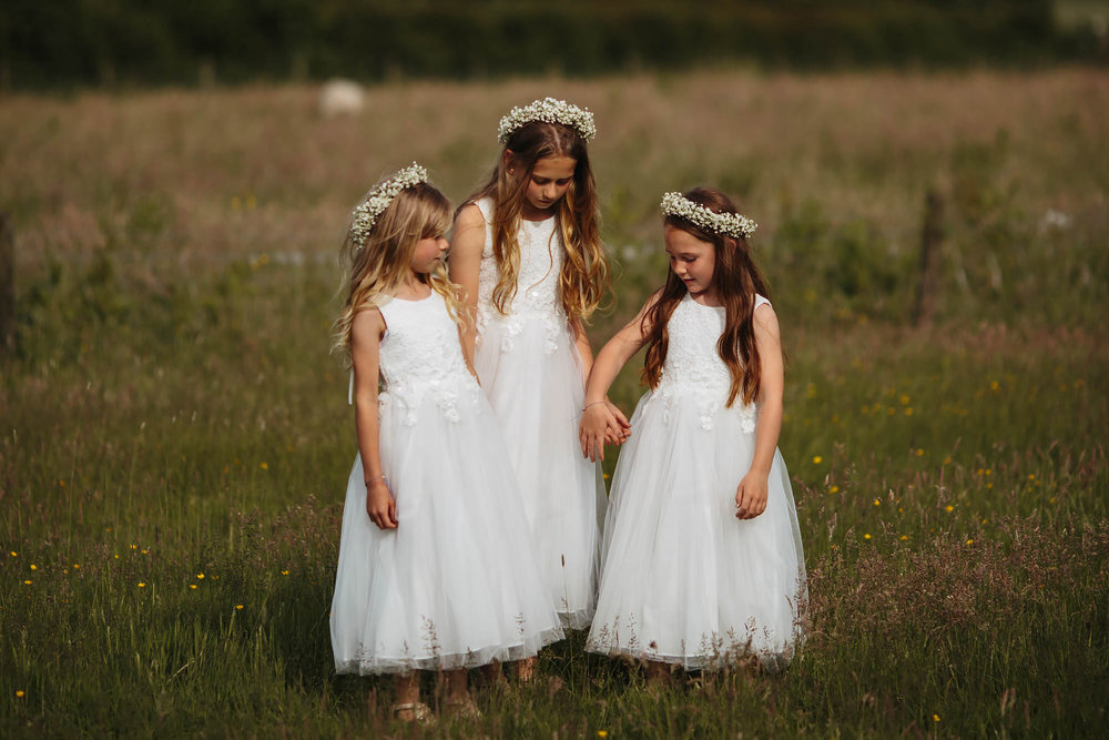 Leeds Yorkshire Wedding Photographer Bridesmaid Flower Girl Holding Hands Child