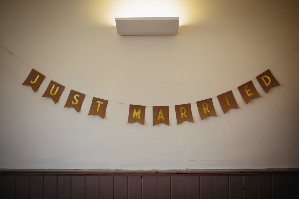 Just married sign at a village hall wedding
