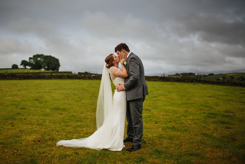 Bride and groom kissing on their wedding day in Lancashire