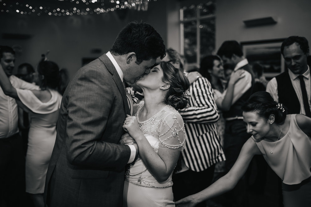 Bride and groom kiss during their first dance at their wedding