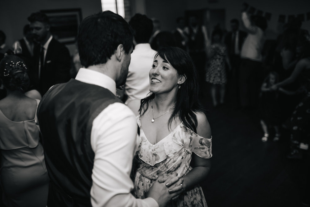 Wedding guests dancing at a village hall in Lancashire