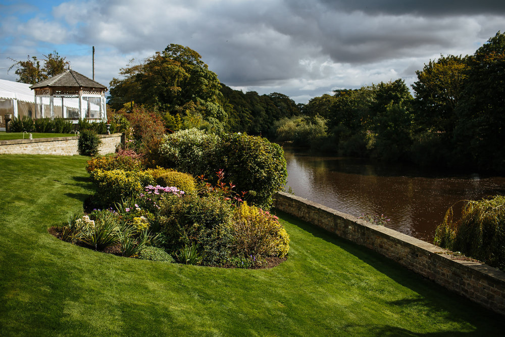 Flowers and bushes at Tanfield House in Yorkshire by the river
