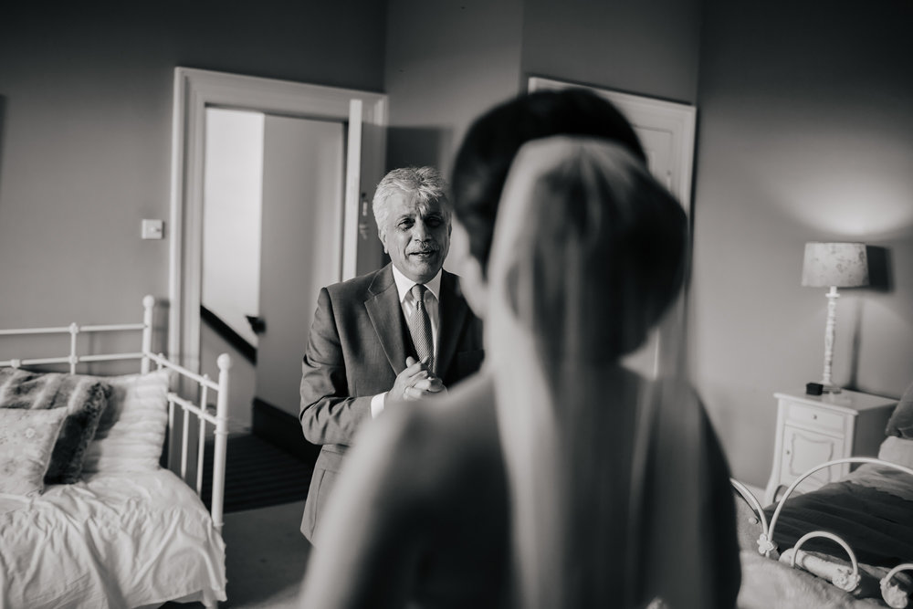 Brides father cries when he sees his daughter in her wedding dress