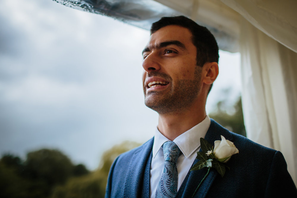 Groom portrait in his suit tie and buttonhole