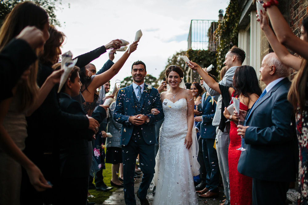 Throwing confetti at a wedding in Yorkshire