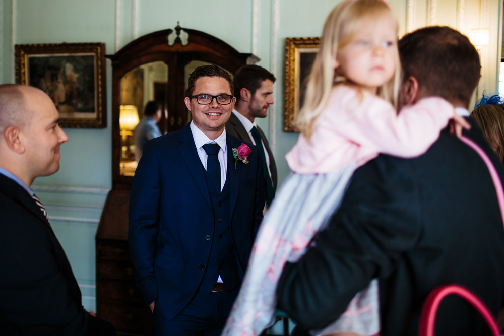 Groom smiling at Thornton Manor in Cheshire at a wedding