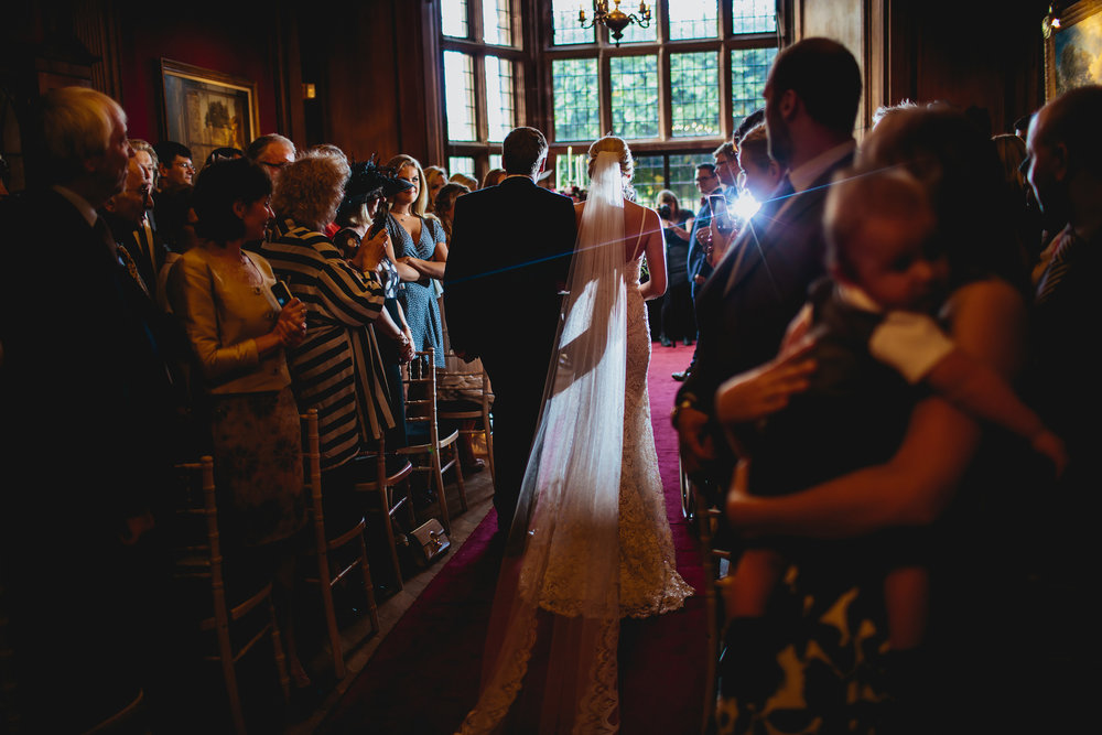 Bride and father walk down the aisle at a wedding