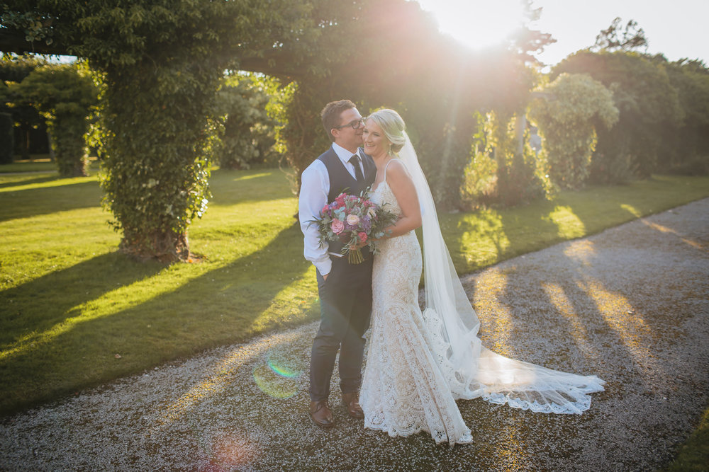 Bride and groom pose in the Cheshire sunshine