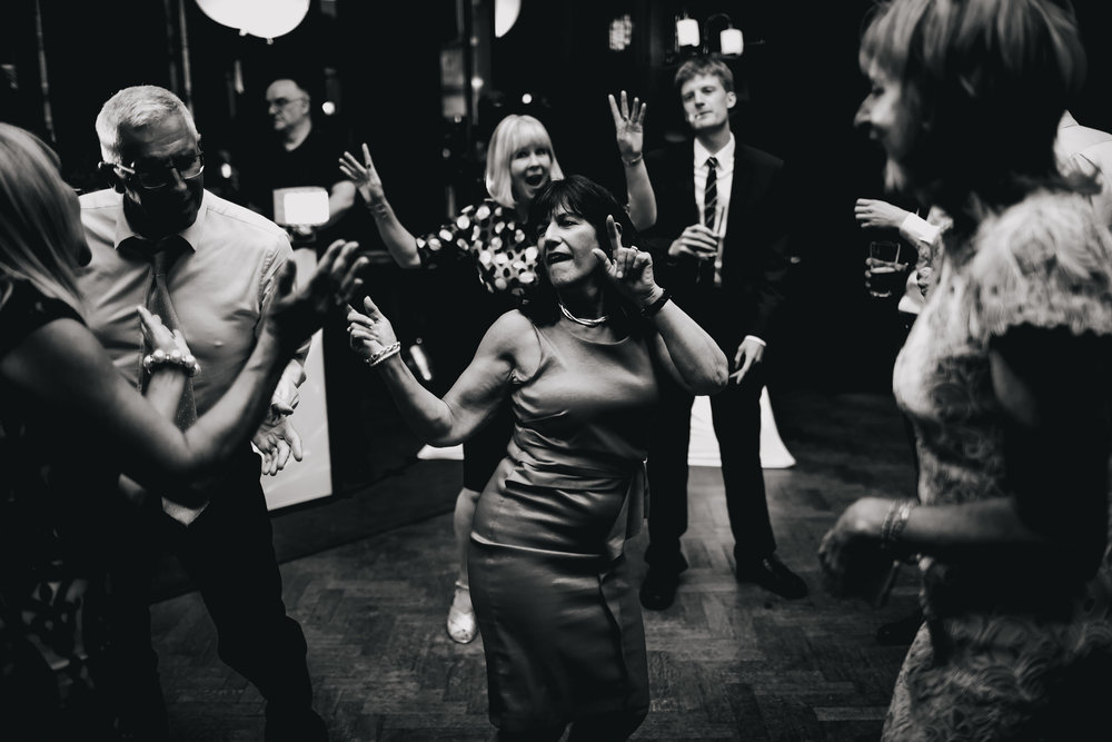 Woman dancing at a wedding in Cheshire