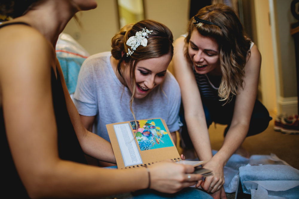 Bride opens photobook on her wedding day