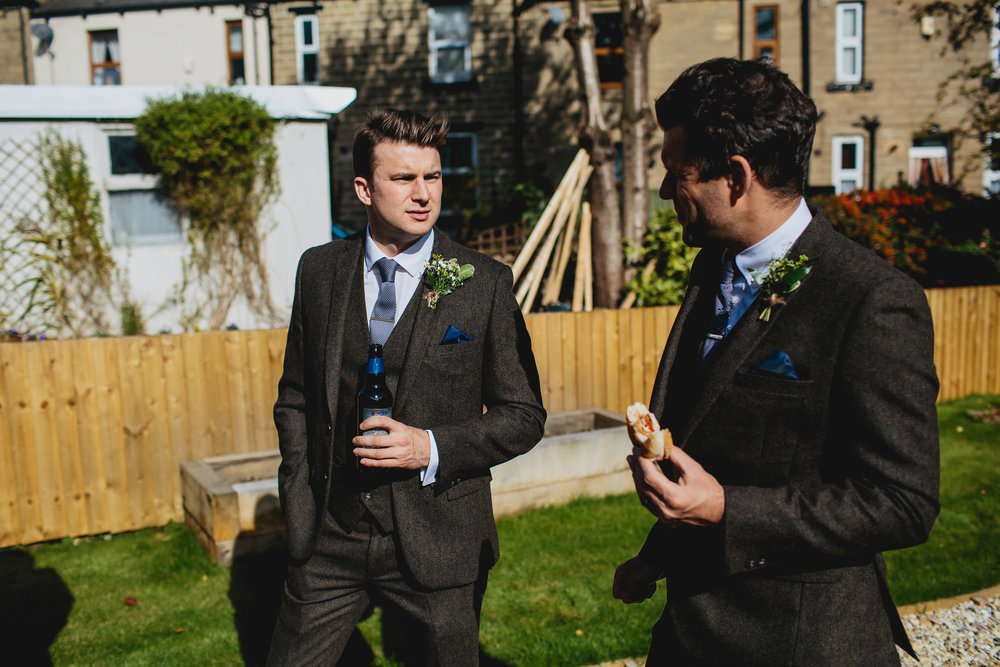 Groom and best man talking in the garden before the wedding