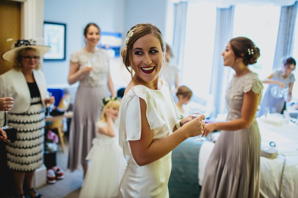 Bride smiling in her wedding dress in Leeds