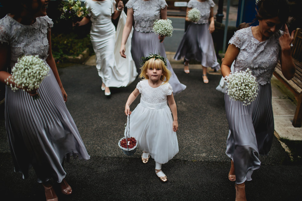 Flower girl walking to the church wedding