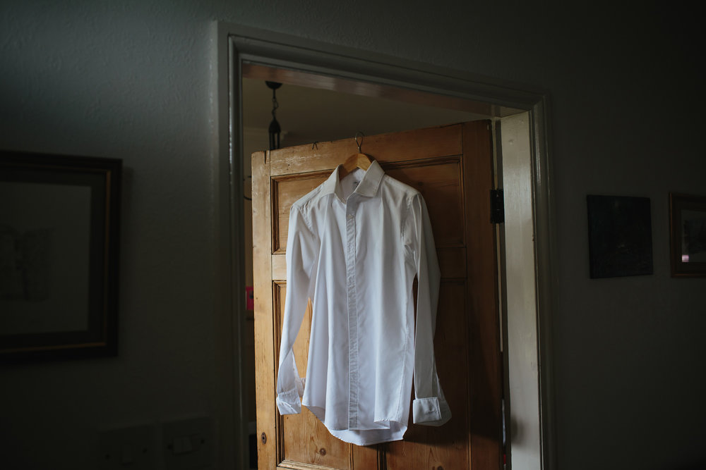 Grooms shirt hanging up before his wedding in Lancashire