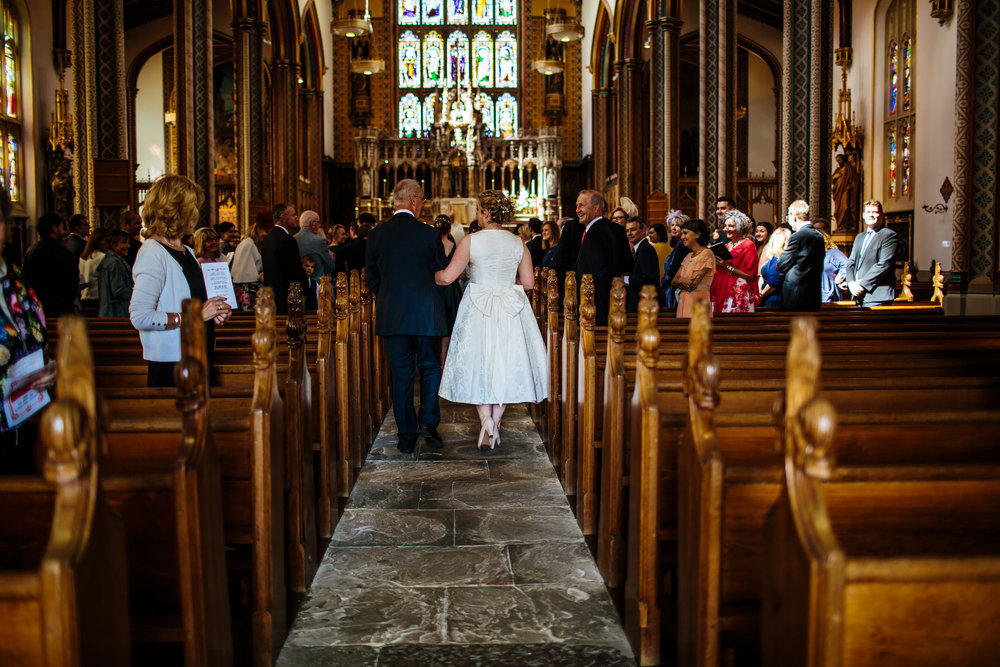Bride and her father walk down the aisle at a Lancashire wedding