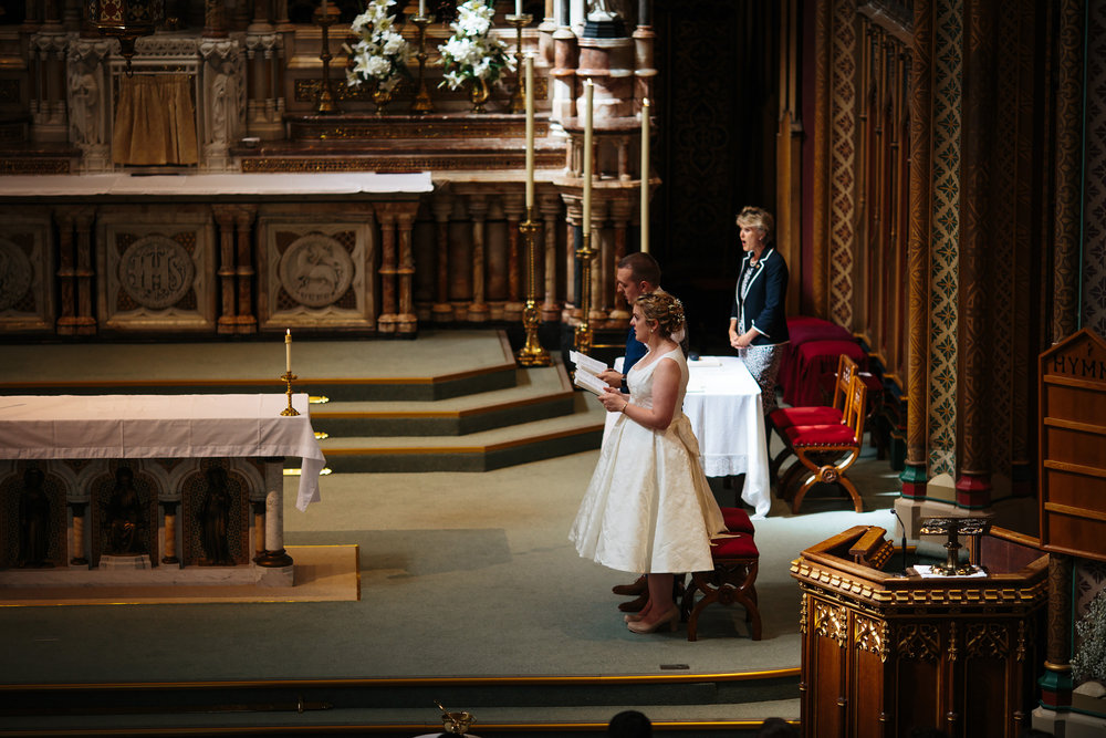Bride and groom singing hymns at their wedding ceremony in Lancashire
