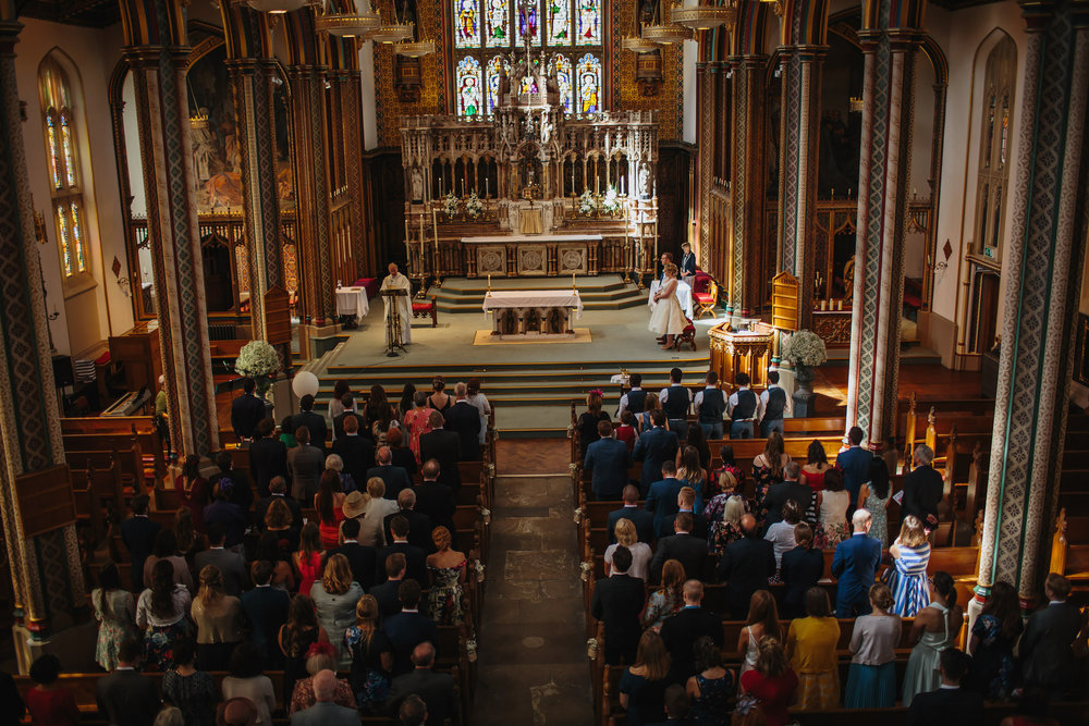 Overview of the church congregation at a Stonyhurst College wedding