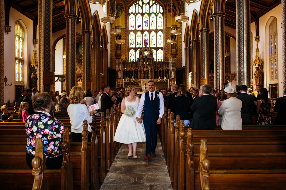 Bride and groom walk down the aisle at Stonyhurst College Wedding