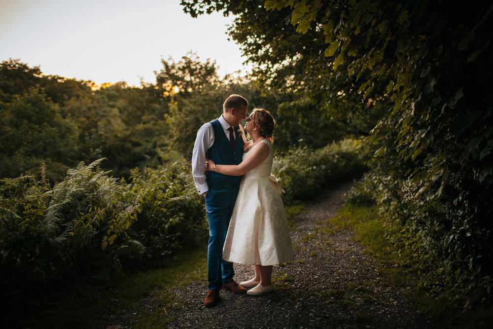Bride and groom pose for a photograph in Lancashire