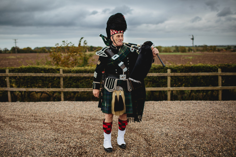 Scottish piper at a Cow Shed Crail wedding