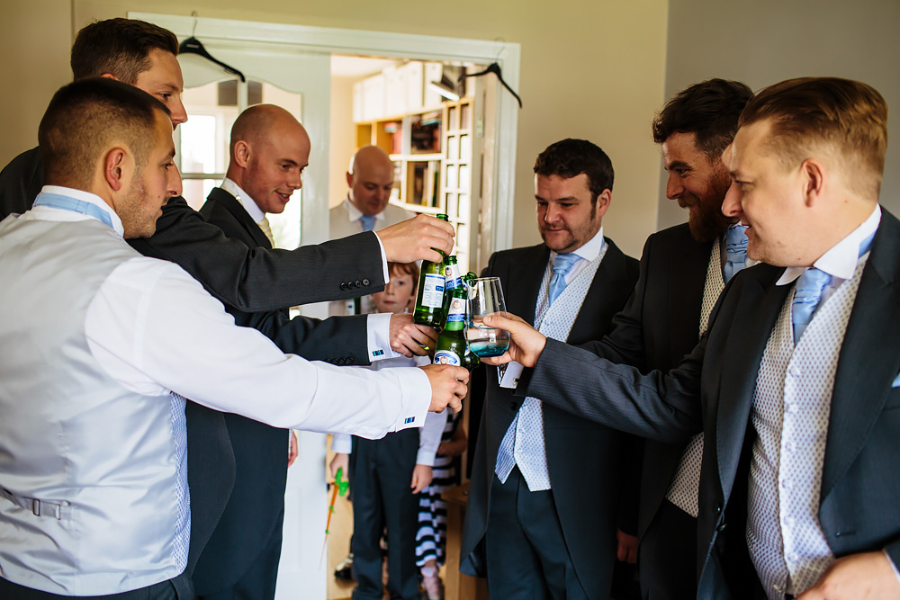 Groom and his best men drinking beer at a wedding