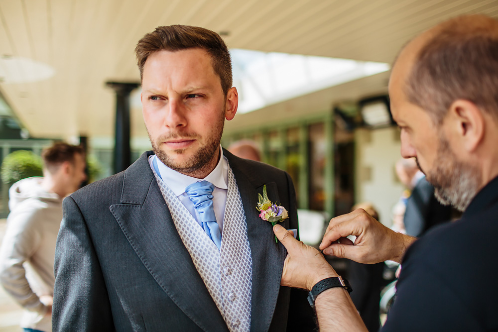 Best man puts his buttonhole on in Lancashire