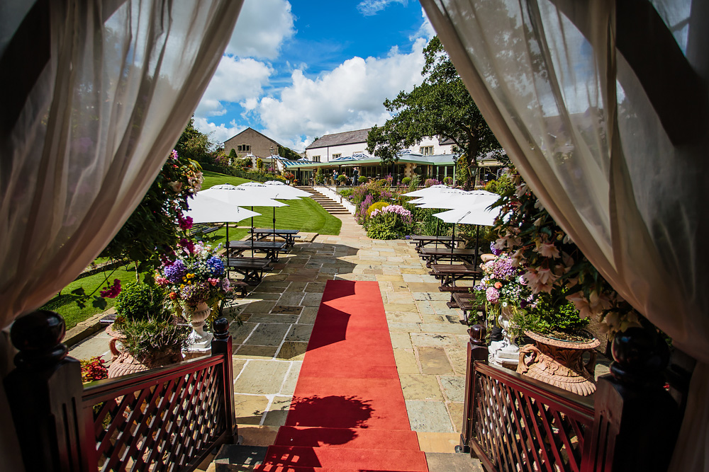 Outdoor ceremony at Gibbon Bridge Hotel Lancashire wedding
