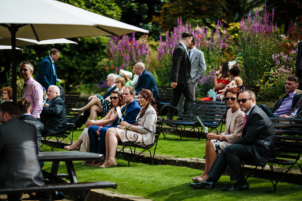 Wedding guests at an outdoor ceremony in Lancashire