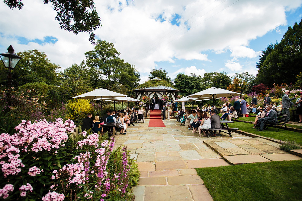 Bandstand in the sunshine at Gibbon Bridge Hotel wedding