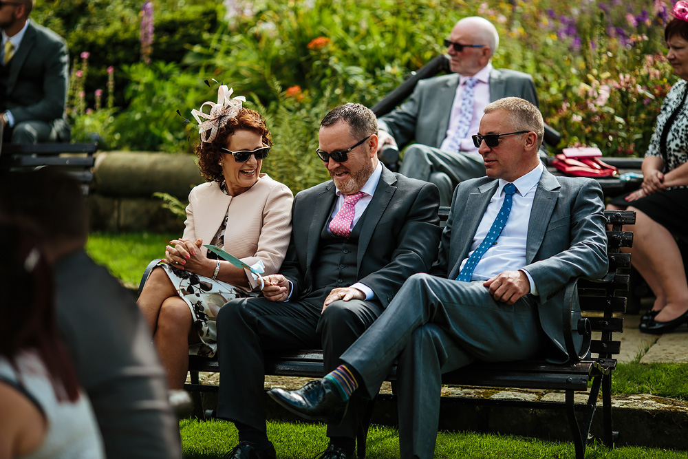 Wedding guests laughing in Lancashire