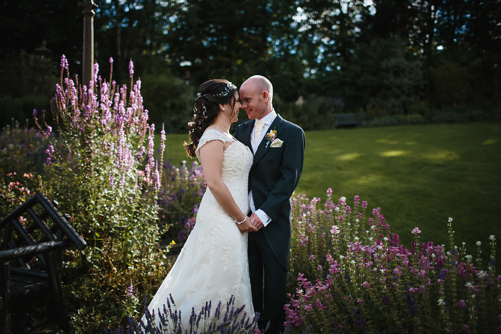Portrait of bride and groom at a wedding in the flowers