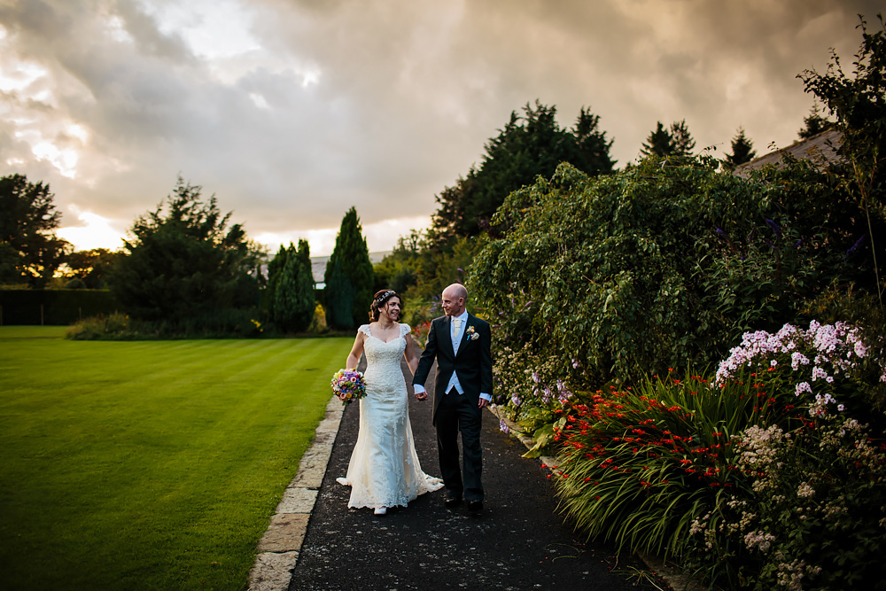 Bride and groom at sunset Gibbon Bridge Hotel Lancashire wedding