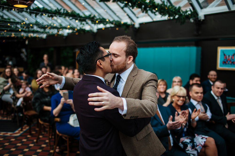 Grooms kissing at a gay wedding in Leeds