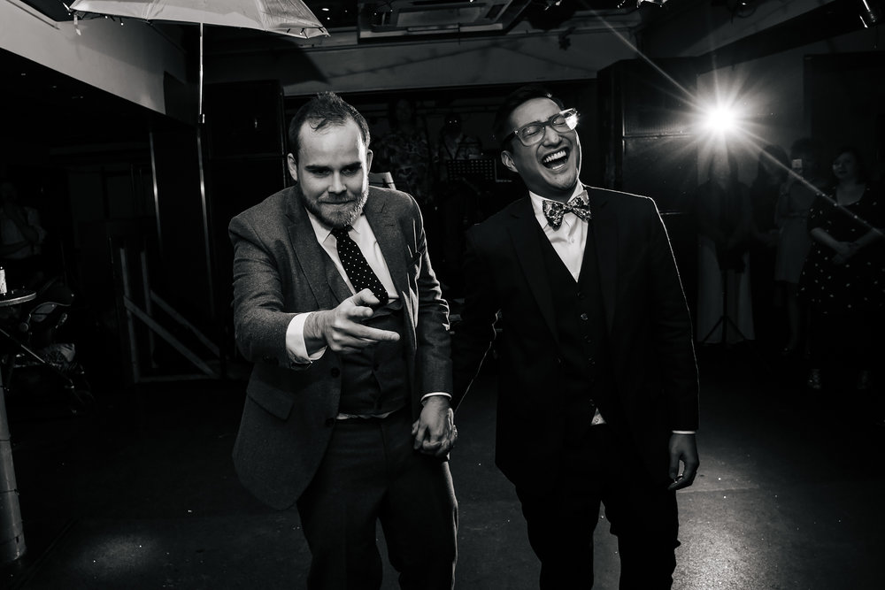 Grooms laughing at a gay wedding in Leeds