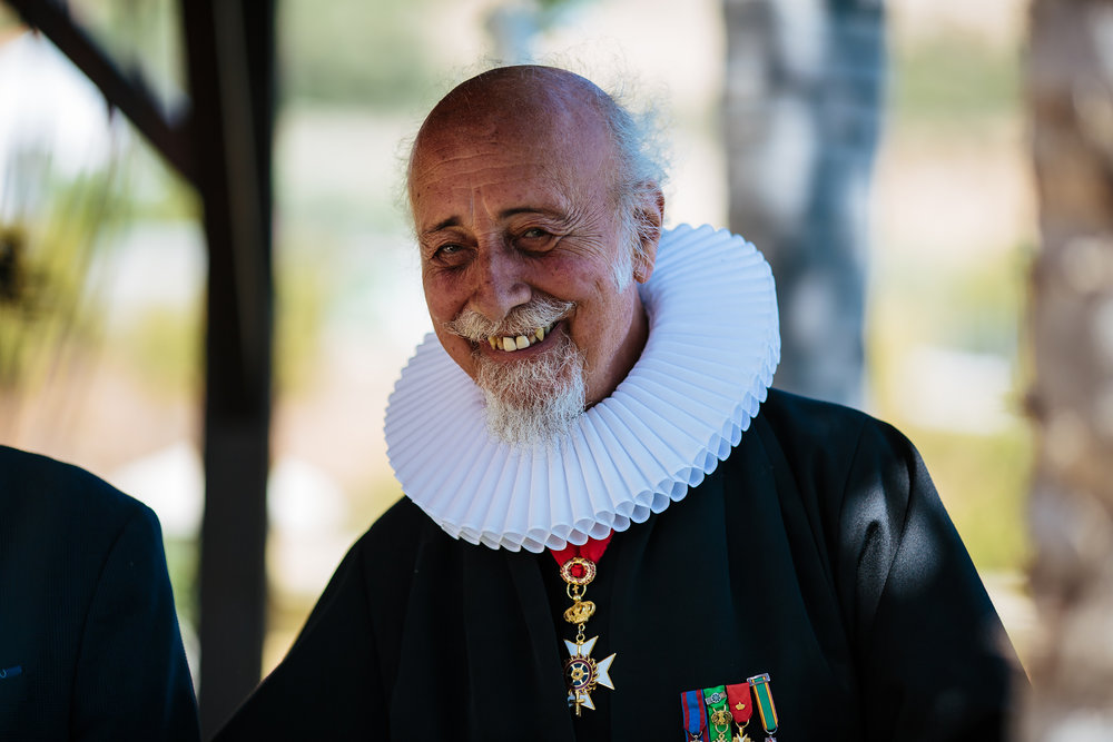 Portrait of the priest at a Spain destination wedding