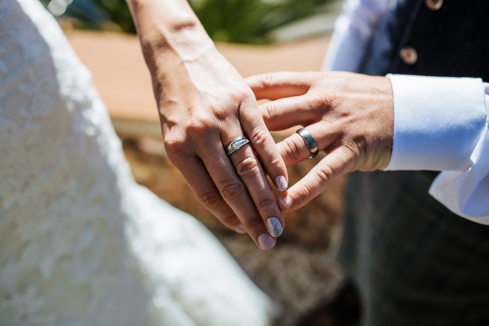 Wedding rings and hands at destination wedding in Nerja Spain