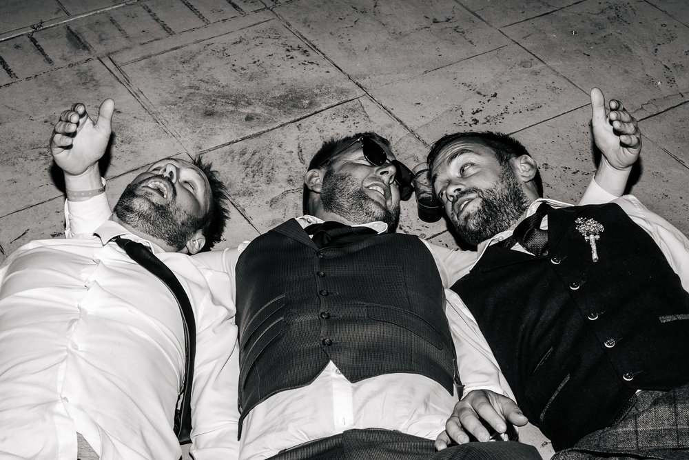 Groom and friends on the floor at a wedding