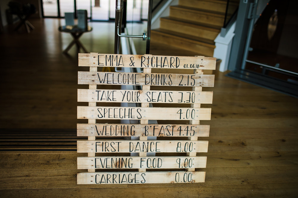 Wooden wedding itinerary sign