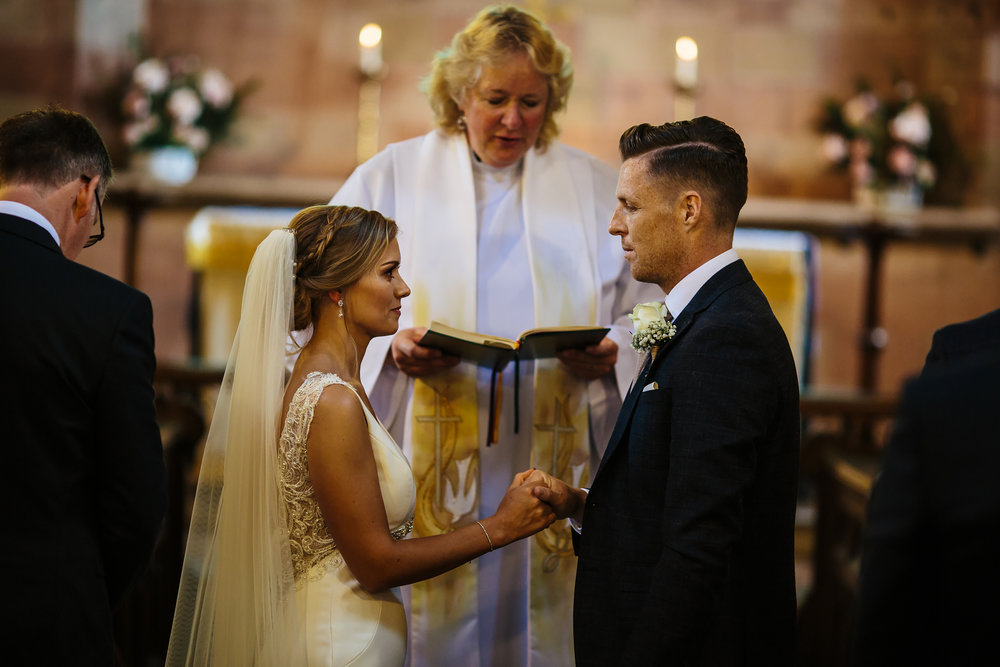 Bride and groom exchange vows in Shropshire wedding