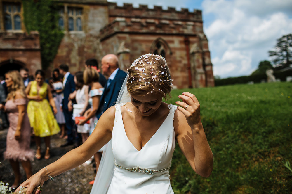 Bride with confetti in her hair at a wedding