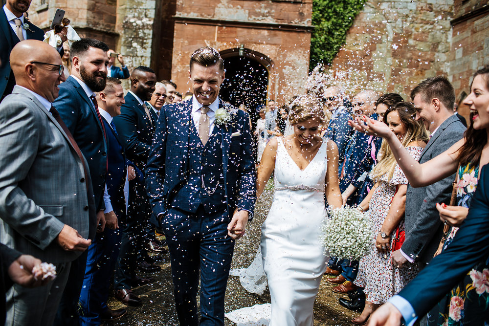 Bride and groom with confetti at a church wedding