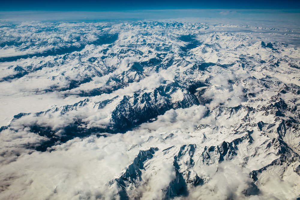 French Alps Peaking Through Clouds
