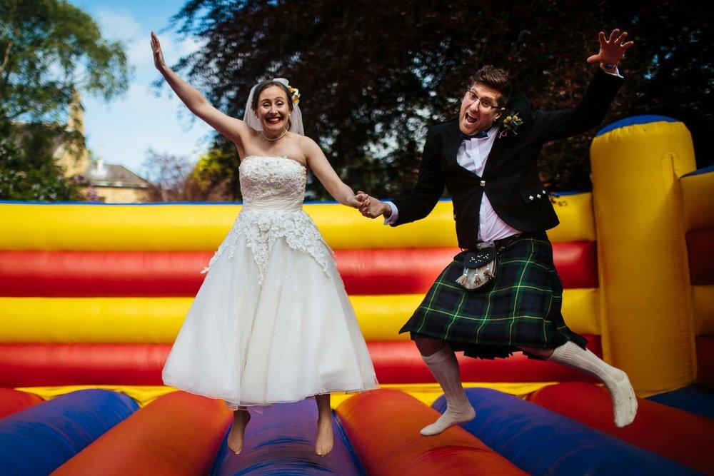 Leeds Yorkshire Wedding Photographer bouncy castle couple