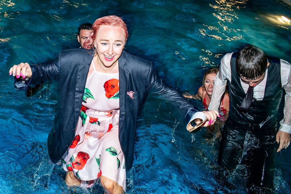 Wedding guests in the pool fully clothed