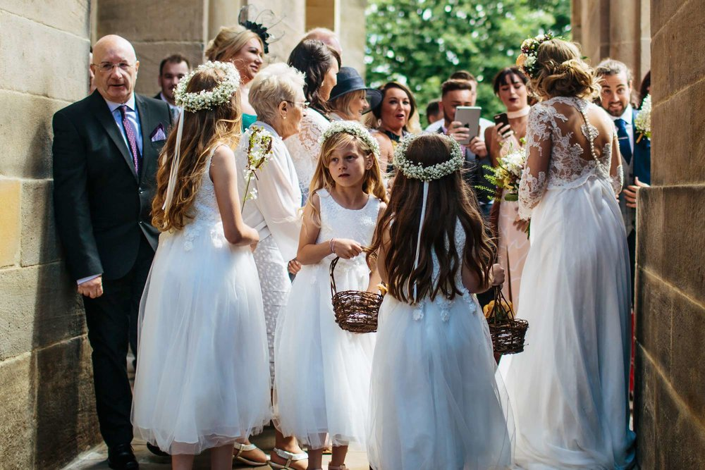 Bridesmaids outside a church wedding in Yorkshire