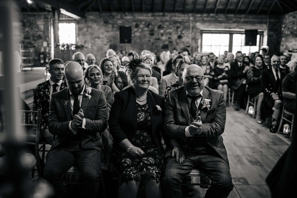 Parents laughing during a wedding ceremony in Yorkshire