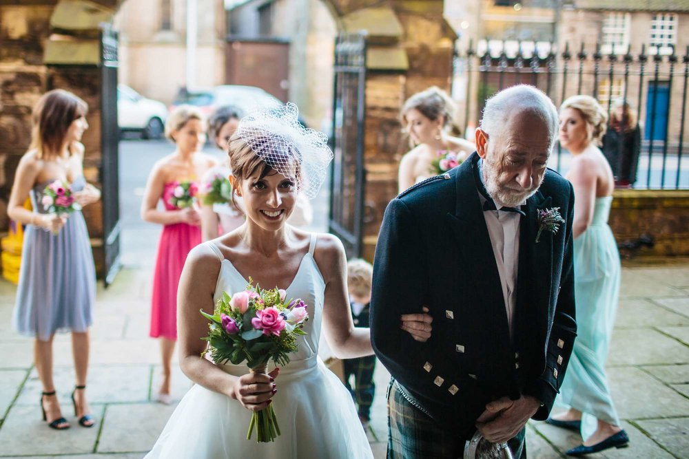 Bride and dad arriving at a church wedding in Harrogate