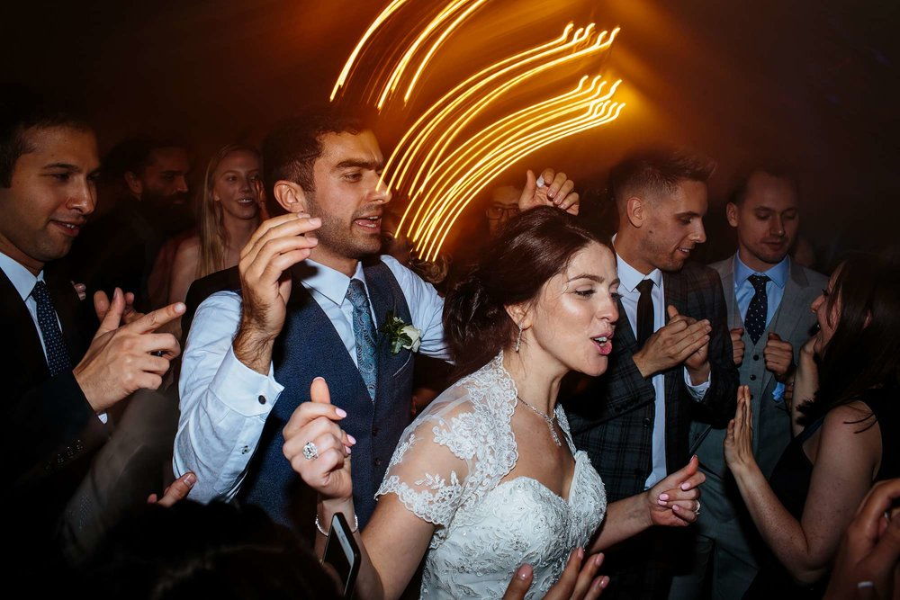 Bride and groom dancing at their wedding in Yorkshire