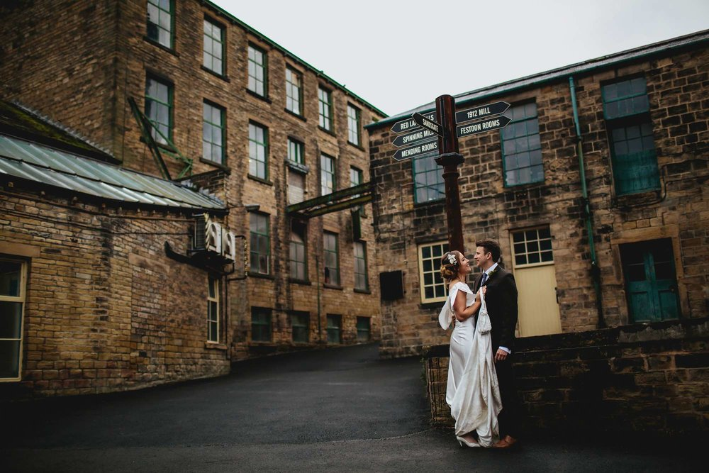 Newly married couple pose at a Mill wedding in Leeds